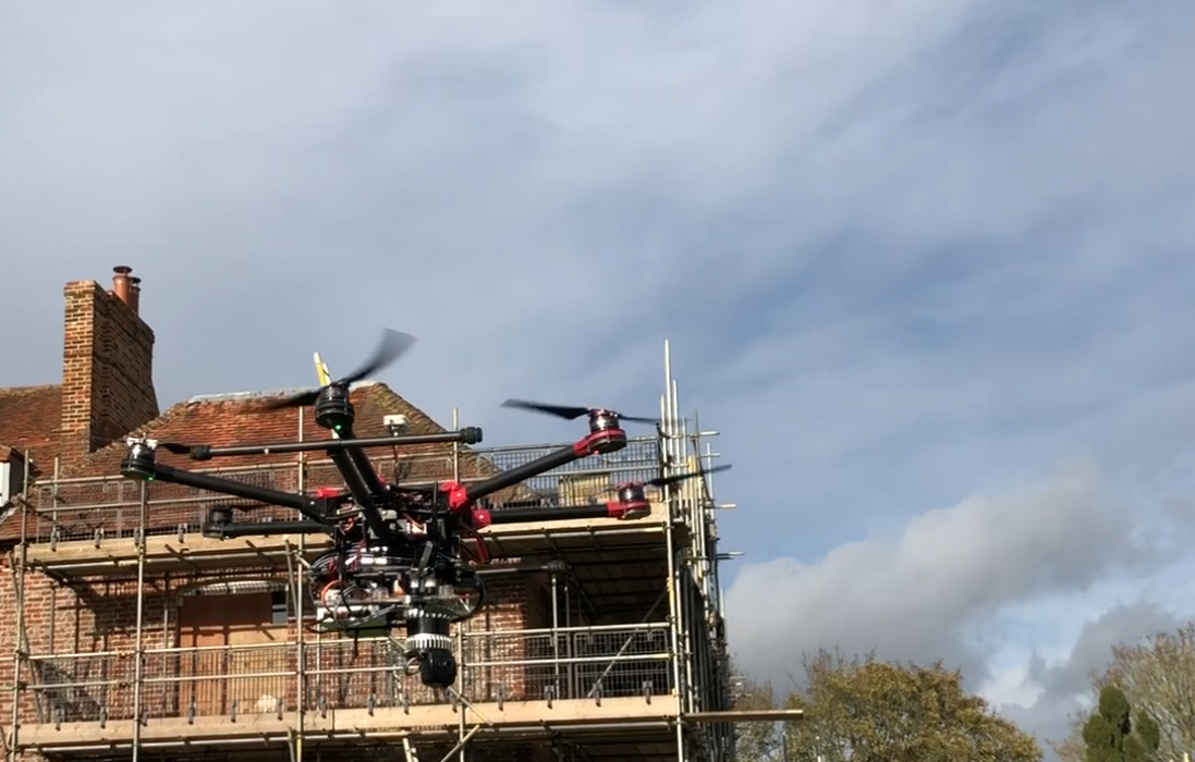 Image of drone flying on a construction site