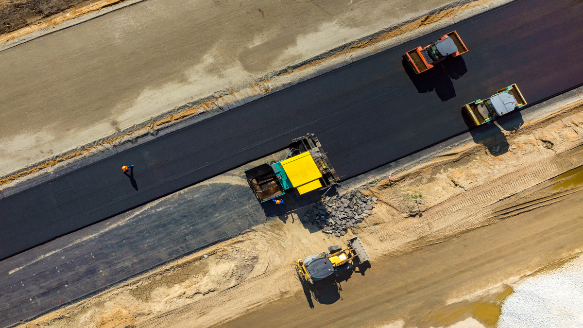 Image of road rollers working on a new road construction site